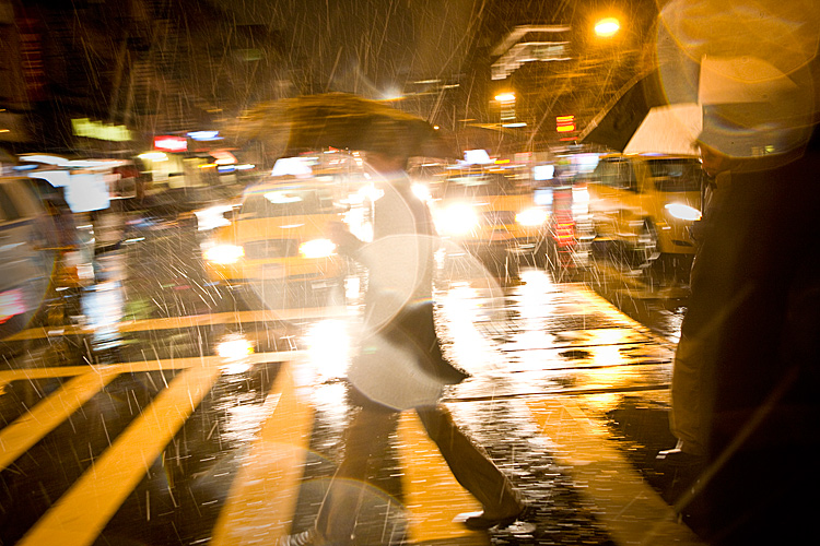 Crossing 8th Av in the Rain (with waiting Taxis) : 23rd and 8th :New York City