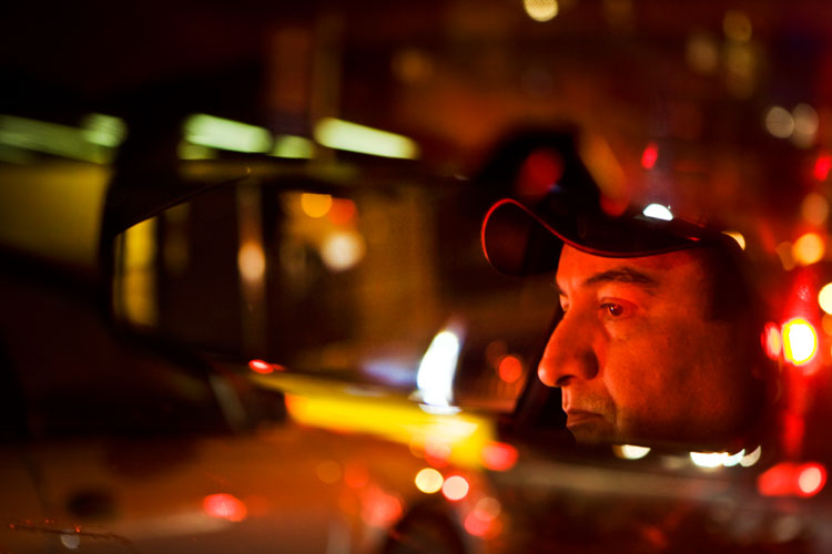 New York Taxi Driver in Drivers Mirror : Astoria, Queens : New York