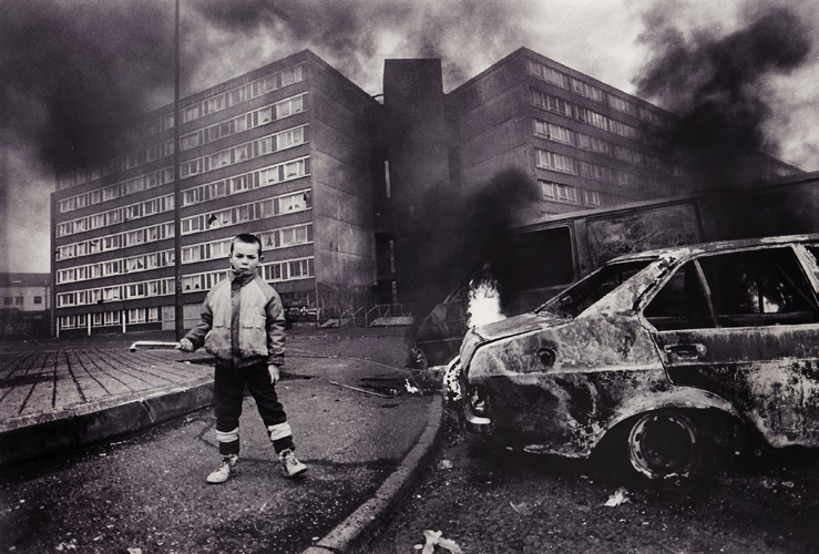 The Troubles : Child with Burning Cars Divis Flats : Belfast : Northern Ireland