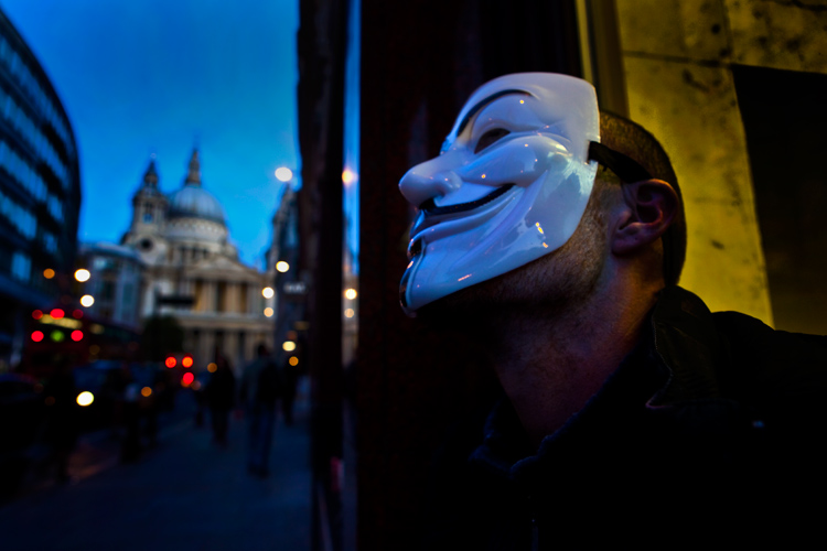 Global Crisis Personal Crisis : Homeless man Guy Fawkes Mask : City of London