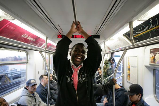 Happy passenger on the 2 line, NYC