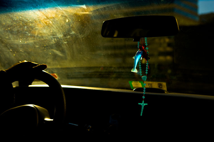 The Taxi Driver, his Lucky Parrot, his Lucky Dolphin and his Crucifix : Dupont : Washington DC