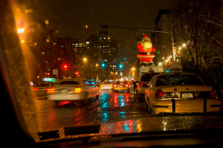 Twenty Foot Blow-Up Santa Survives the Wind, Sleet and Snow of a Nor'easter Storm : 3AM Saturday Night,  9th Av at 20th St : NYC