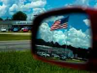 Car Culture : Flag Over Dealership Lafayette : Louisiana