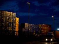 Night Falls but Global Trade Goes On : Containers Piled High and Leaving by Road : Felixstowe Docks : UK