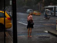 Hard to get a Taxi in the Rain : New York City : USA
