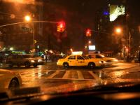 Taxi, Storm, lonely guy and the poster Girl : 14th and 9th Av : NYC